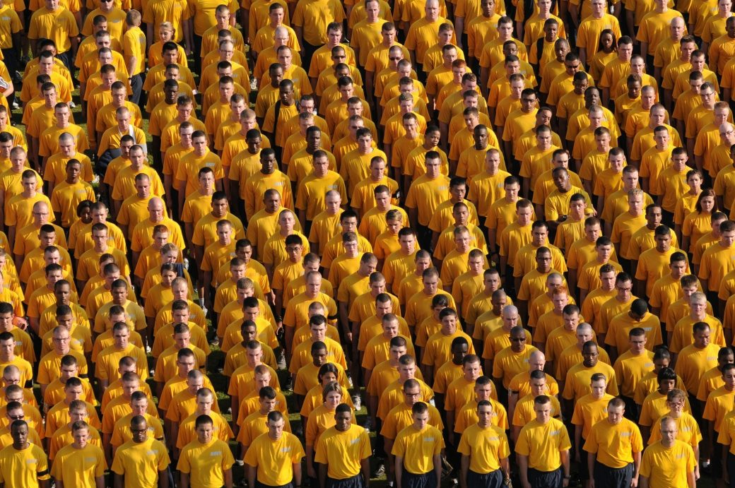 People aligned wearing yellow teeshirts